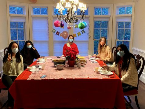 "From left to right, seniors Zia Sun, Sahana Ramesh, Julia Kao-Sowa, Julia Feldhaus, and Anoushka Sarkar celebrate ""Friendsgiving"" as well as Kao-Sowa"