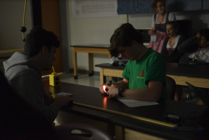 Students in the Astronomy class participate in a lab activity.