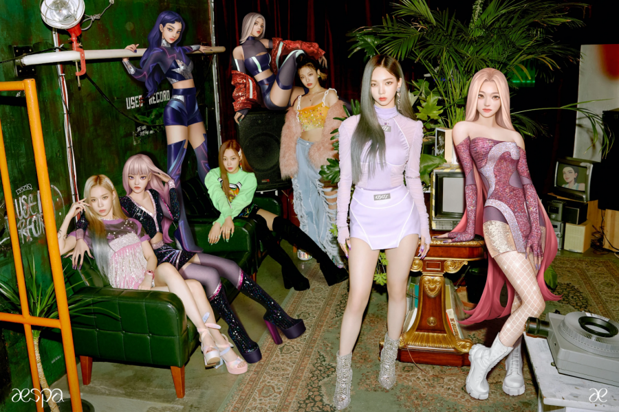 Aespa poses for their first full-group photoshoot. From left to right, the eight members are Winter, aeWinter, aeGiselle, Giselle, aeNingNing, NingNing, Karina, and aeKarina. Photo courtesy of allkpop.com.