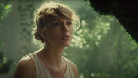"Taylor Swift gazes up at the clouds in the music video of ""Cardigan"", a song in her latest album, ""Folklore""."