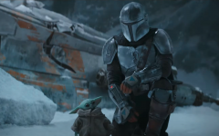 A scene from the second episode of 'The Mandalorian' shows the protagonist walking alongside a younger Yoda.