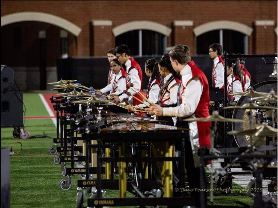 Jefferson's marching band front ensemble gets set up and ready to play at one of their concerts during the 2019 season.