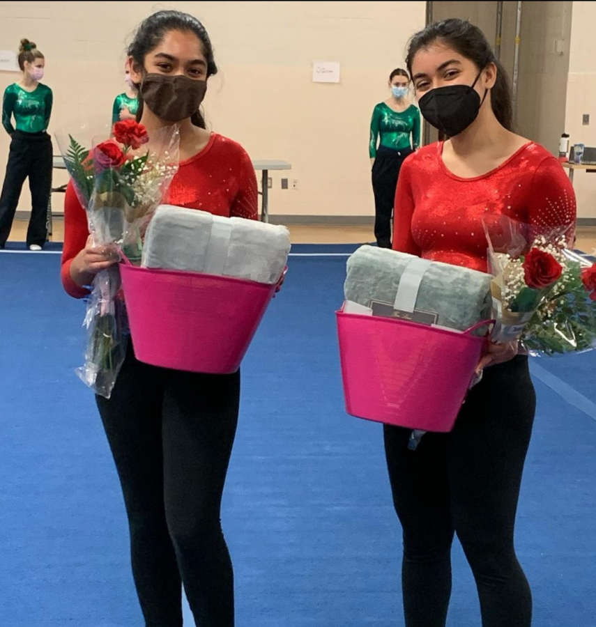 Seniors Navya Vargese (left) and Lisa Raj Singh (right) receive flowers and gift baskets at senior night.