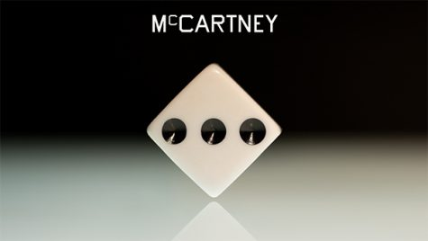 "The album cover for ""McCartney III"" is a typographic painting by artist Ed Ruscha, focused on the face of a dice showing the number three."