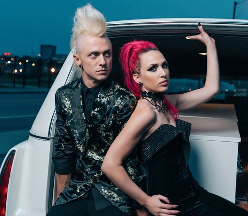 On the left is Shawn Jump, the duo's guitarist, and on the right is vocalist Ariel Bloomer. The two are the members of Icon for Hire.