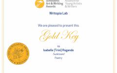 Junior Trini Rogando receives a Scholastic Gold Key for her poetry entry,