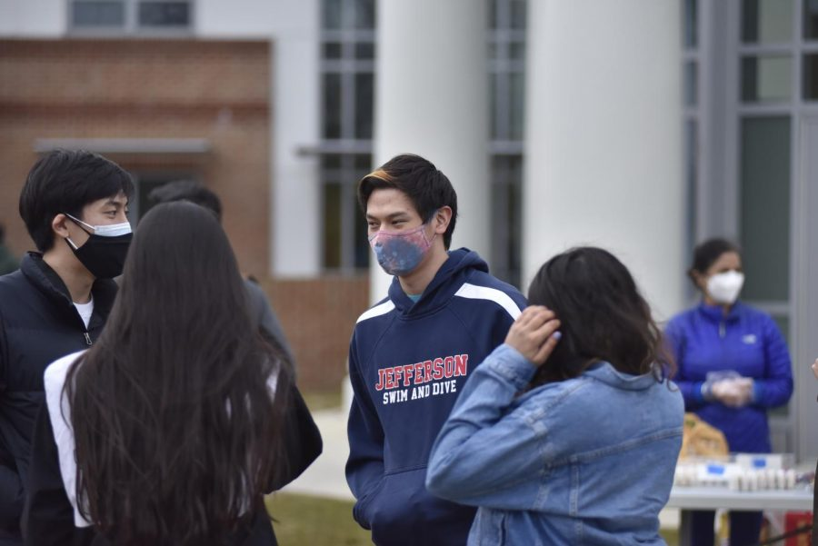"Seniors gathered outside the dome at Jefferson on Feb. 27, 2021. They caught up with each other while snacking on food. ""It surprisingly went better than expected,"" Hwang said. ""We expected a lot of people to not be able to come due to the drive to TJ, but it went pretty well."""