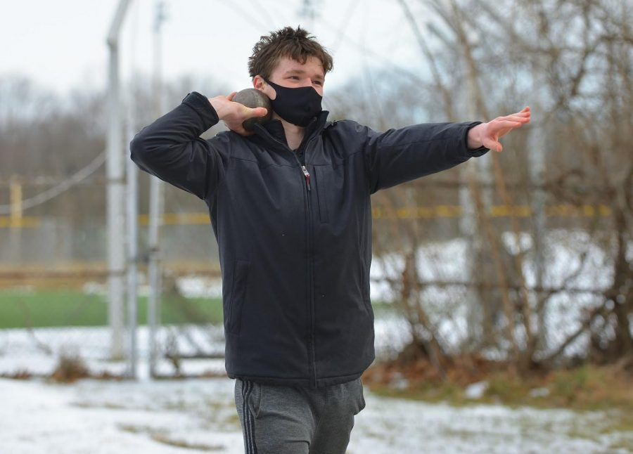 "Junior David Lyons practices a shot put throw for track and field. ""The only way [winter sports] could've been better is if we didn't have to work around COVID, so the only way to improve them would be for everyone to be COVID safe,"" Lyons said."