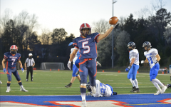 Senior running back Niko Economos (5) scores a touchdown for the Colonials in the second quarter, giving the Colonials a 6-0 lead.