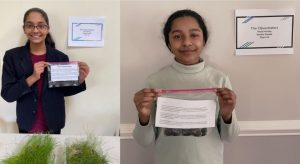 Veda Murthy and Varsha Gunda, the winners of this year's Invitational Science Fair, show their group project on urban carbon sinks.