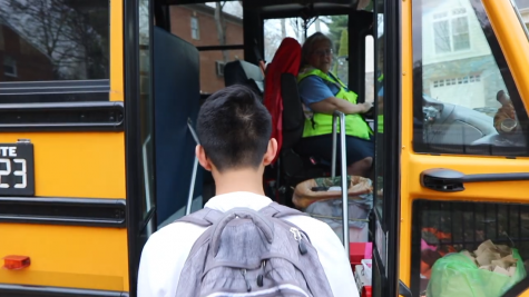Early in the morning, a student steps onto the only bus serving Arlington students going to Jefferson