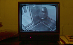 The last footage of Elisa Lam on a CRT television set.