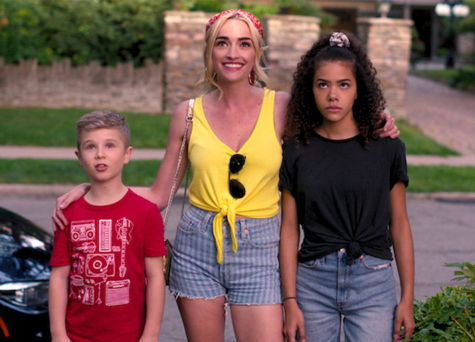 "Georgia Miller (Brianne Howey), with her two kids, Ginny on the right (Antonia Gentry), and Austin (Diesel La Torraca) to her left, starting out their journey on their first day in Wellsbury. As a fast-paced TV show, ""Ginny and Georgia"" covers the family's highs and lows throughout their time in the small town they later come to know and love."