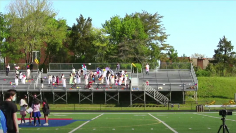 Students gather on the bleachers, waiting for a pep rally to begin on Apr. 17.