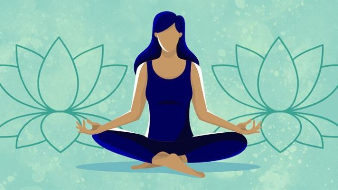 A woman meditates outside with the sounds of nature. Meditation improves focus and allows the mind to escape anxiety and stress from the day.