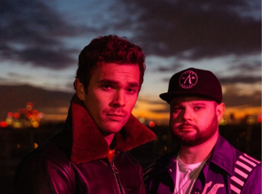 "Mike Kerr and Ben Thatcher (left and right, respectively) are the two members of the UK rock band Royal Blood. The rock duo recently released their third studio album ""Typhoons"" on April 30, 2021."