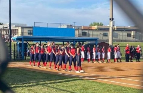 "The Jefferson softball team lines up for assembly at Marshall High School during their game. It was their second game of the season, and it was postponed due to the weather. ""It was kind of last minute, it wasn"