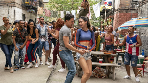 """Everyone enjoys a backyard fiesta in """"In The Heights"""", seemingly unaware of the 100+ degree weather."""