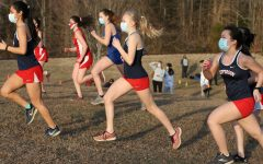 Junior Kaia Wright and other competitors raced with masks on in a spring 2021 cross country meet.