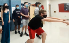 """Seniors Spencer Miller (main), left to right- Hailena Bian, Akash Piya, James  Xu, Akash Pamal spirit bomb an AP Chemistry class during Homecoming week. A long-time tradition at TJ, students are finally able to get back into spirit bombing.""""Spirit bombing is a really fun way to get hype during hoco week and release a ton of energy,"""" Akash Pamal said."""