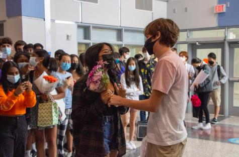 Sophomore Richa Dhakal holds flowers from sophomore Kaan Eguz's asking.