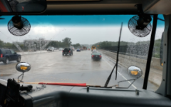 Bus 410 drives down I-495 in the after leaving late due to the torrential downpour.
