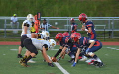 Senior Oliver Tu and the rest of Jefferson's defensive line face off against the FCA Bucks early in the game.