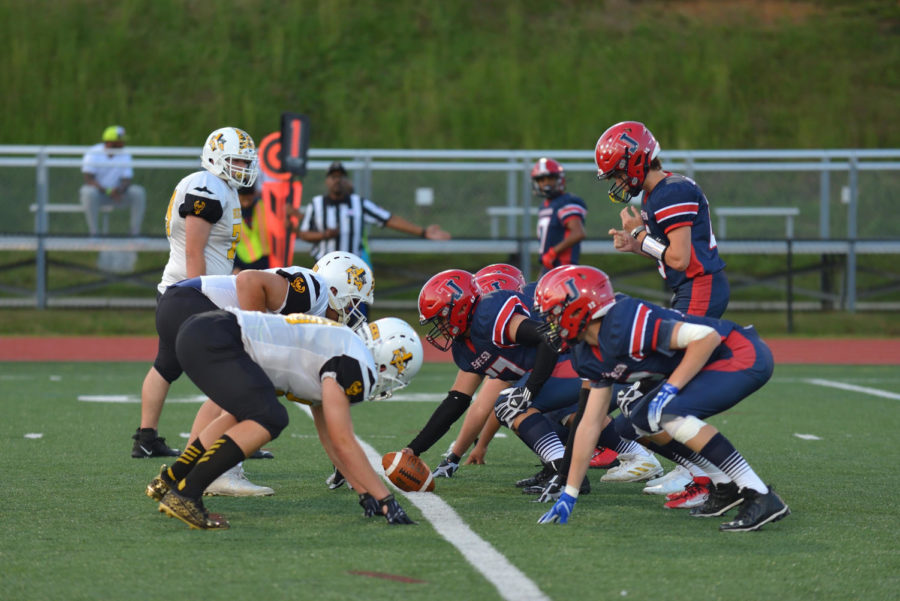 Senior Oliver Tu and the rest of Jeffersons defensive line face off against the FCA Bucks early in the game.