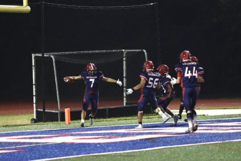"""Justin Yoo (7) celebrates with his teammates moments after scoring his first touchdown of the game. On 2nd and 1, Yoo broke out for a 29-yard touchdown rush to give Jefferson the lead. """"He [Justin] broke through 5 tackles and it genuinely deserves to go on SportsCenter,"""" senior kicker Joshua Park (13) said."""