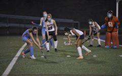 Senior Nora Fareeha and sophomore Nina Garces defend their goal in a junior varsity field hockey game against Marshall High School on Mar. 10, 2021.