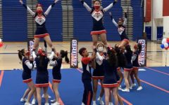 """Jeffersons cheer team showcased their routine at the Red, White and Blue Spirit Bash at Alexandria City High School. """"We made a lot of last minute changes which made it extra stressful to do, but I think we didn't do bad and tried our best,"""" freshman Hasvika Challa said."""